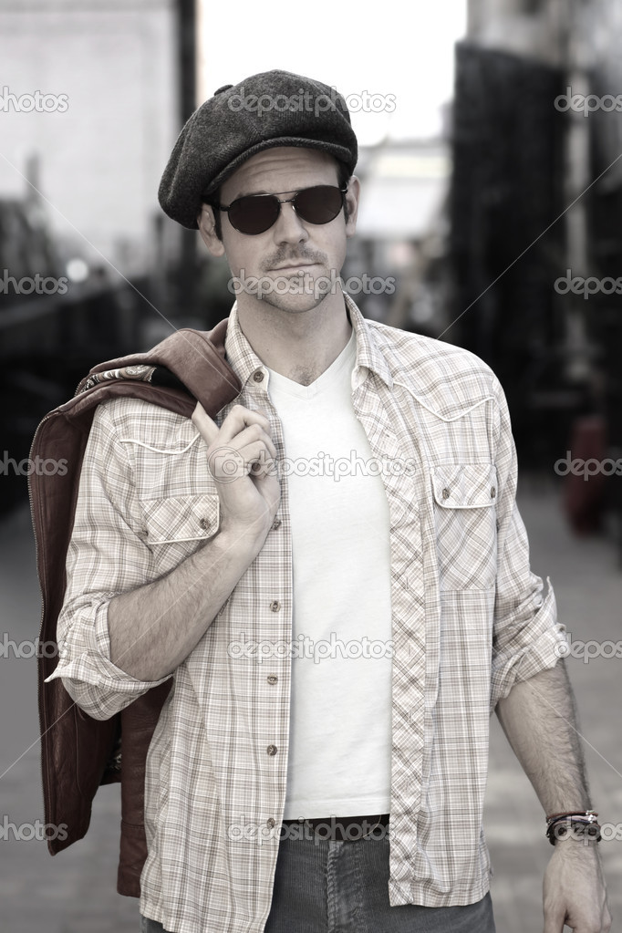 Stylized fashion portrait of cool male model in hat and shades with a retro vibe — Stock Photo #8813366