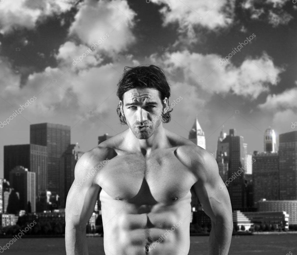Fine art black and white portrait of a sexy muscular model making expression against background of dramatic sky and city — Stock Photo #8896343