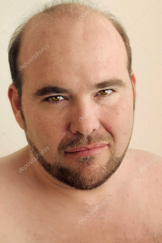 Detailed closeup portrait of a mature balding man with beard against warm neutral background — Stock Photo #8909281