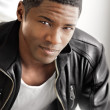 Young black man in leather — Stock Photo