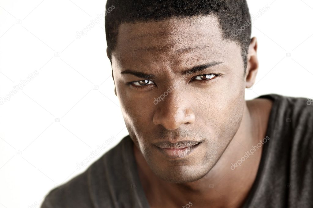 Highly detail portrait of young good looking man staring at viewer against white neutral background  Stock Photo #8978342