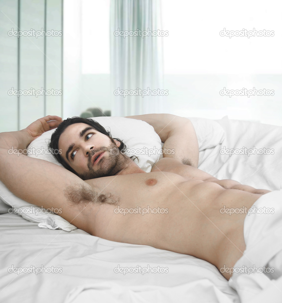 man in bed naked
