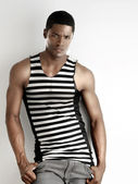 Sexy black man in stripes — Stock Photo