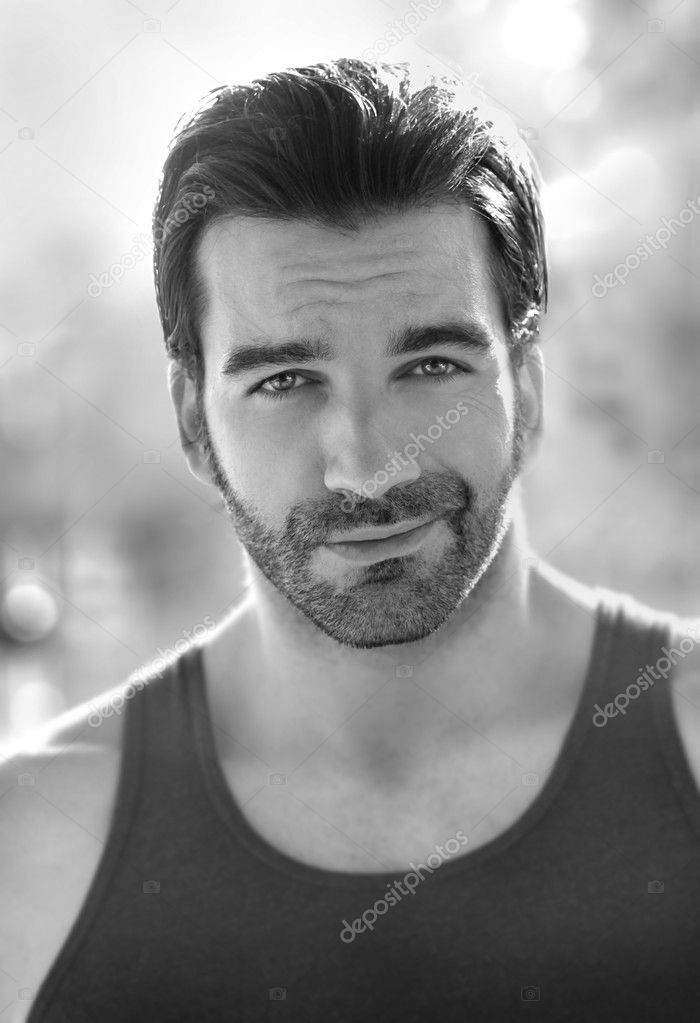 Outdoor black and white portrait of a classically good looking masculine man outdoors  Stok fotoraf #9150603