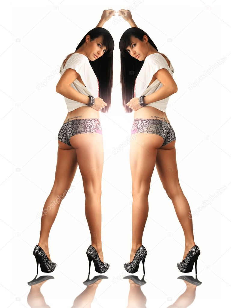 Portrait of a sexy slim female model with long legs from behind reflecing in  mirror — Stock Photo #9150633