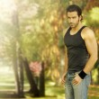 Male model in park setting — Stock Photo