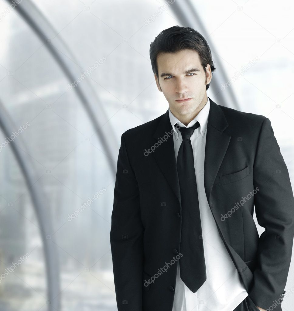 Portrait of a young good looking business man in bright modern office space  Stock Photo #9388388