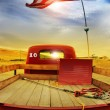 Retro truck and vintage flag - Stock Photo