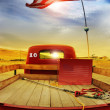 Retro truck and vintage flag — Stock Photo