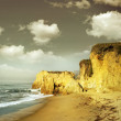 Shoreline cliffs in golden light - Stock Photo