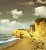 Shoreline cliffs in golden light — Stock Photo