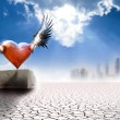 Winged heart in modern world — Stock Photo