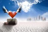 Winged heart in modern world — Stock Photo