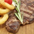 Juicy beef steak cooking — Stock Photo