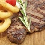 Juicy beef steak cooking — Stock Photo #10063363