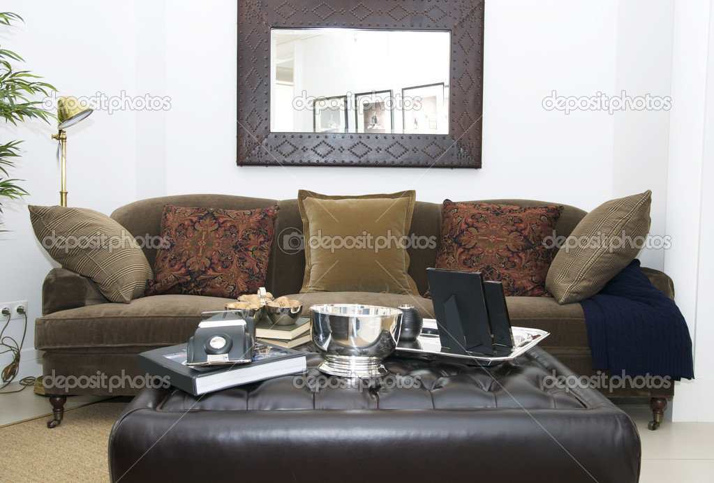 Cozy living room with table and sofa — Stock Photo #10066596