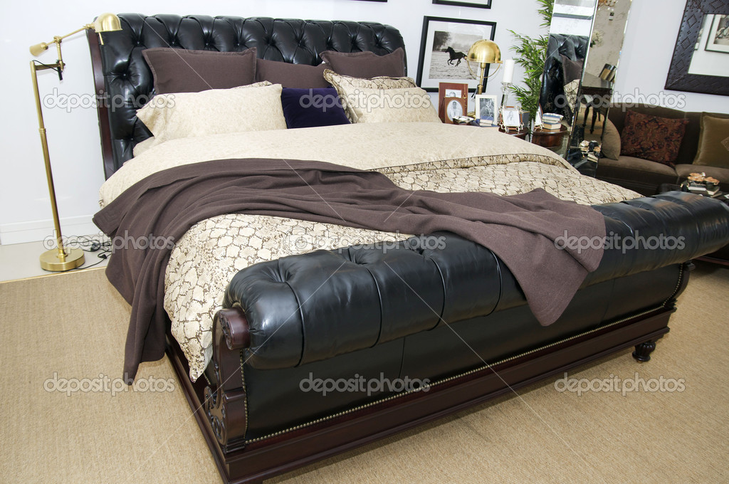 Bedroom with leather bed  Stock Photo #10066604