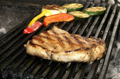 Steak on the grill — Stock Photo