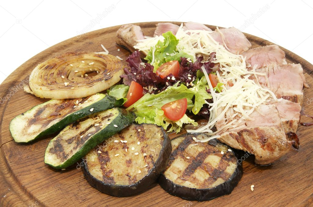 Grilled vegetables and meat on a wooden platter — Stock Photo #10500737