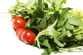 Tomatoes and fresh herbs — Stock Photo