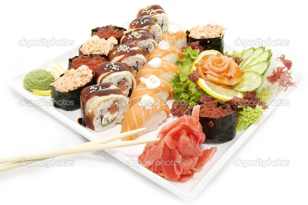 Large plate of sushi and cucumber salad decoration — Stock Photo #9102856