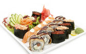 Large plate of sushi with vegetable — Stock Photo