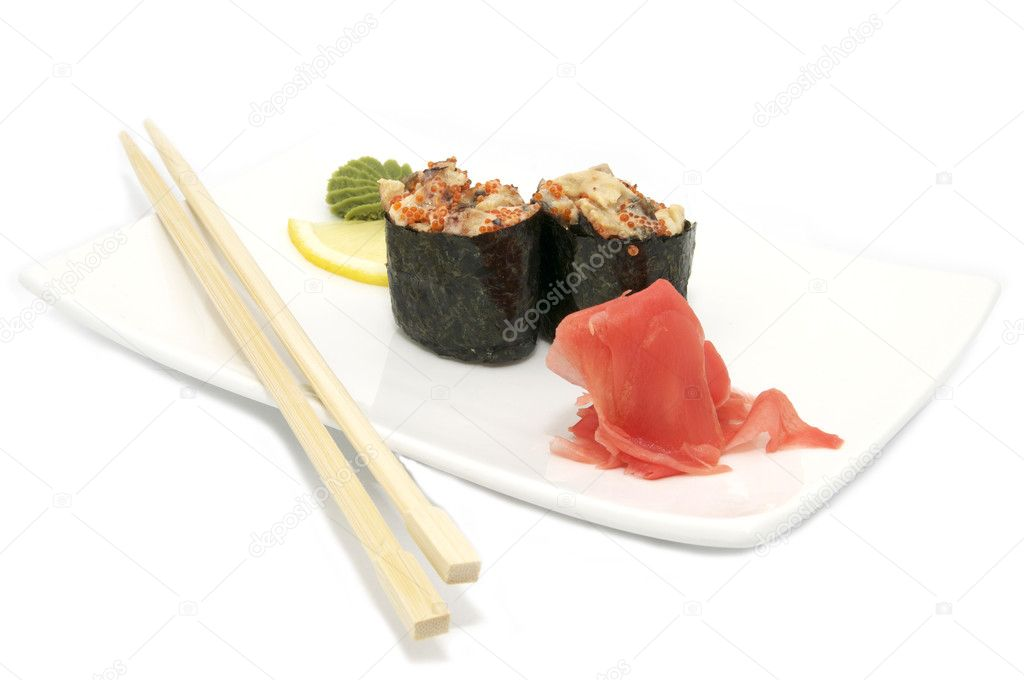 Sushi and chopsticks on the Japanese plate — Stock Photo #9409785