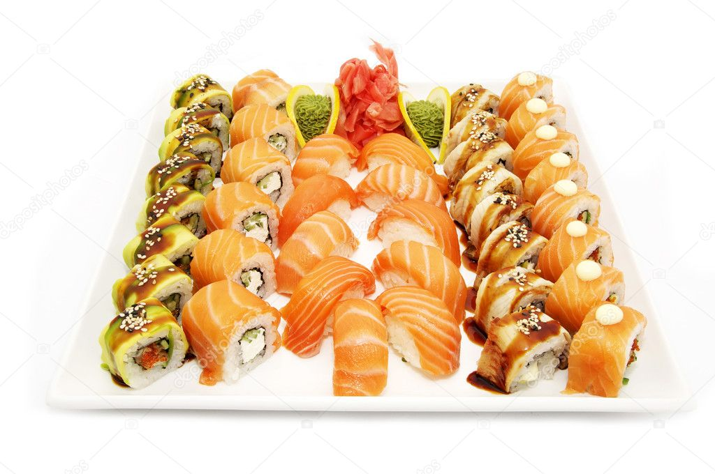 A large plate of Japanese sushi on white background  Stock Photo #9409795