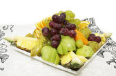 Plate with fruits and berries — Stock Photo