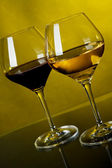 Two glasses of wine on a yellow background — Stock Photo