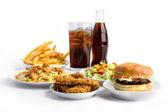 Snabbmat och cola på vit bakgrund — Stockfoto