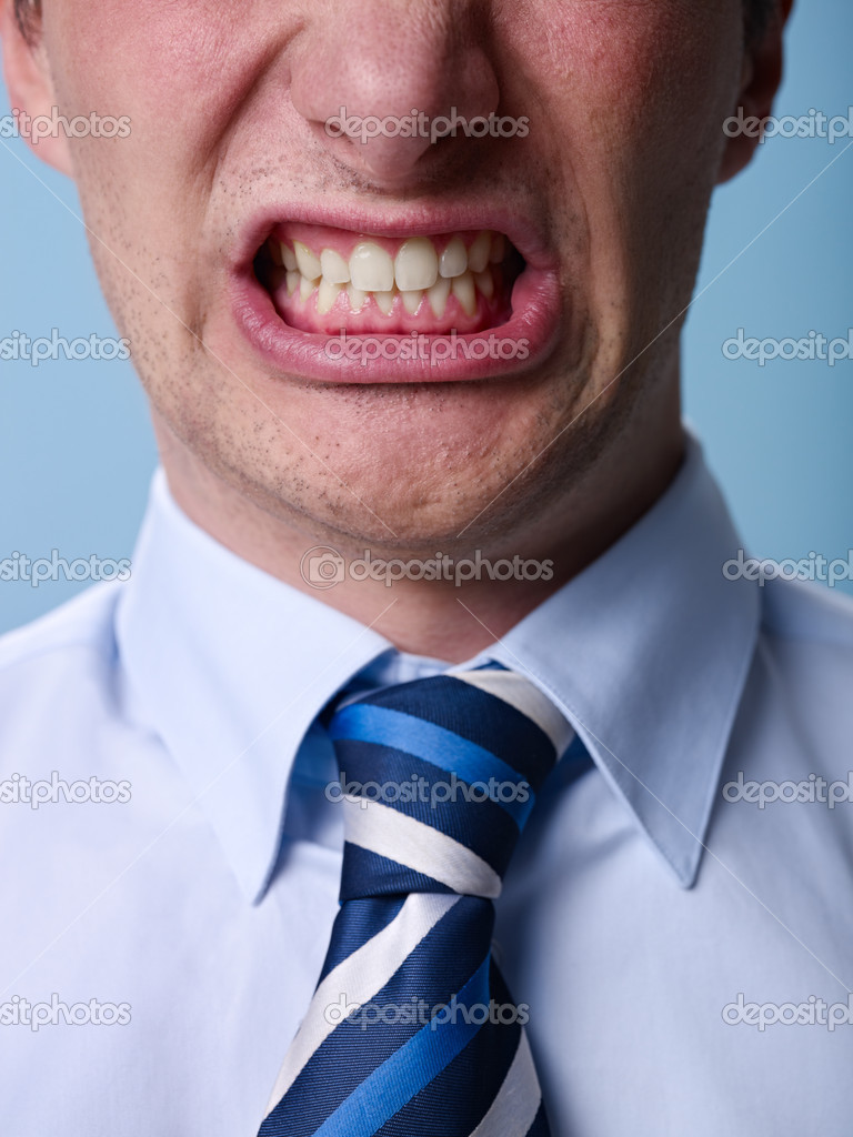 Closeup of businessman screaming against blue background. Vertical shape  Stock Photo #10302012
