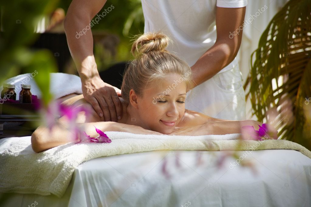 Young beautiful blonde caucasian woman gets massage and beauty treatment in luxury resort. Horizontal shape, side view — Stock Photo #8402703