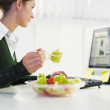 Businesswoman eating salad — Stock Photo
