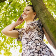 Young woman in park, smiling — Stock Photo