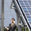 Businessman and solar panels — Stock Photo #9301231