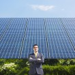 Businessman and solar panels — Stock Photo #9301235