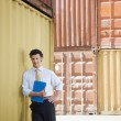 Business man with shipping containers — Stock Photo #9302064
