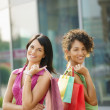 Royalty-Free Stock Photo: Friends with shopping bags