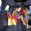 Stock Photo: Women shopping in limousine