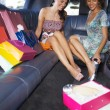 Women shopping in limousine — Stock Photo #9302441