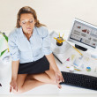 Businesswoman doing yoga - Stock Photo