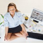 Businesswoman doing yoga — Stock Photo