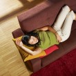 Stock Photo: Woman sleeping on sofa