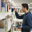 Man choosing book in library — Stock Photo