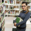 Portrait of girl in library — Stock Photo