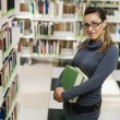 Stock Photo: Portrait of girl in library