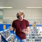 Guy listening music in cd store — Stock Photo