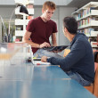 Two guys studying in library — Stock Photo