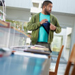 Royalty-Free Stock Photo: Student stealing laptop in library